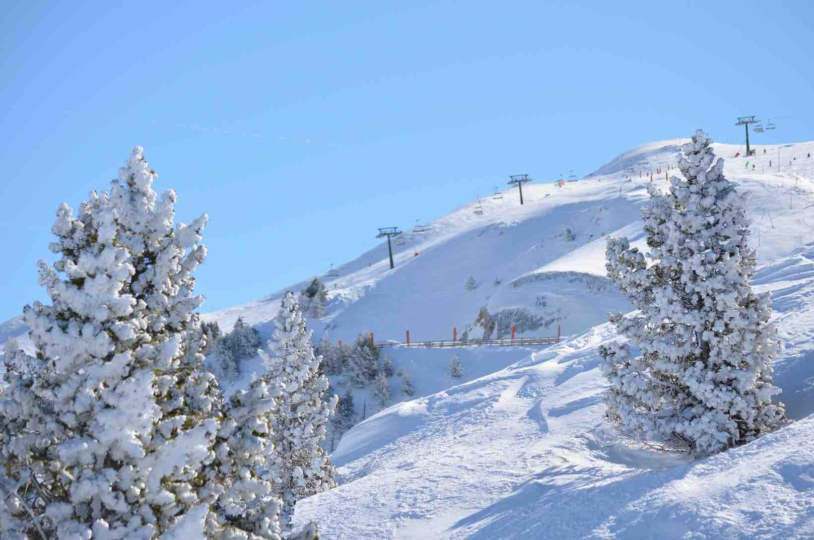 Photo of ski lifts and snowy mountains at Baqueira Beret