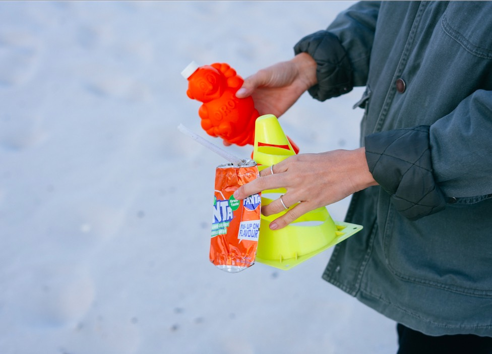 goals of sustainable development: picking up rubbish from the snow