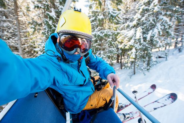 A skier wearing a mask on the open ski resorts in Canada