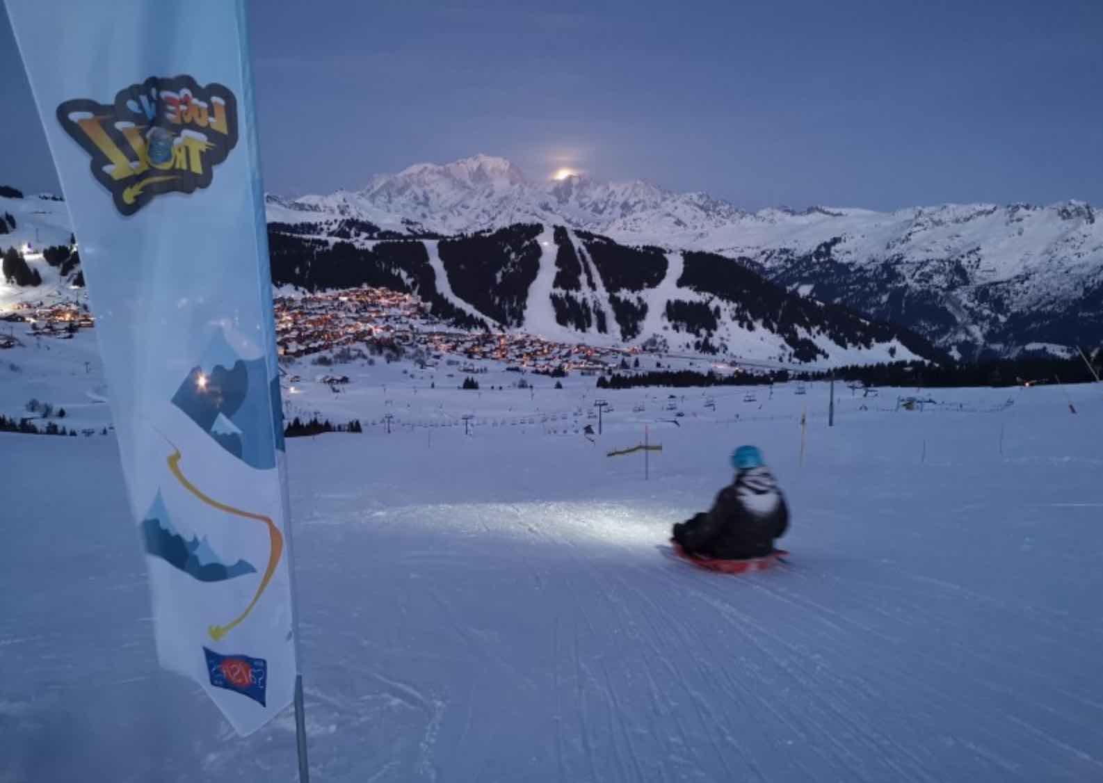 Nightime sledding on Les Saisies part of iloveski Ski holiday