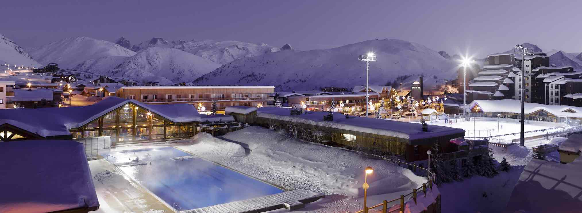 outdoor pool at Alpes d'Huez with views of the surrounding mountains